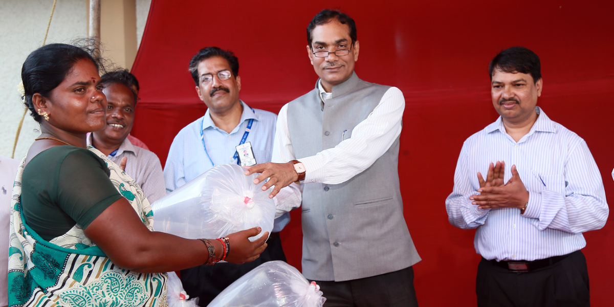 Dr. Trilochan Mohapatra, Hon. DG ICAR and Secretary, DARE is handing over hatchery produced seabass seeds to farming women during his visit to CIBA